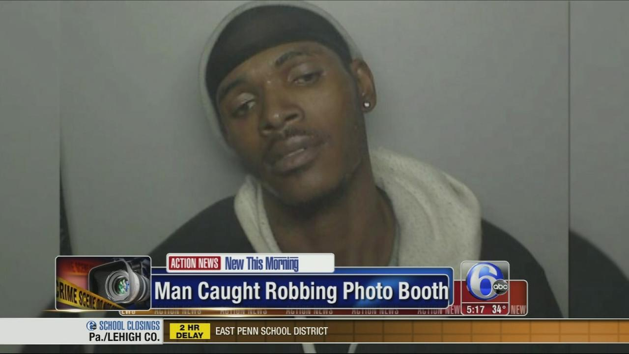 VIDEO: Man caught allegedly robbing photo booth