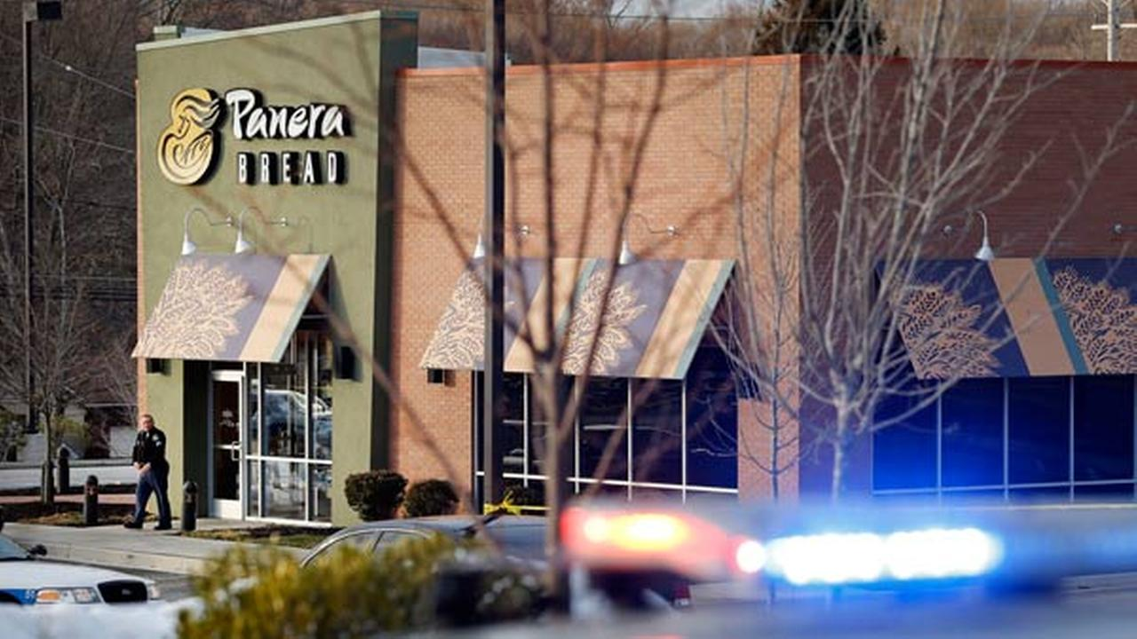 An investigator walks at the scene of a shooting at a shopping center in Abingdon, Md., Wednesday, Feb. 10, 2016. A man opened fire inside the crowded restaurant during lunchtime.