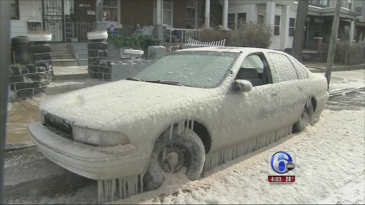 VIDEO: Water line break encases cars in ice