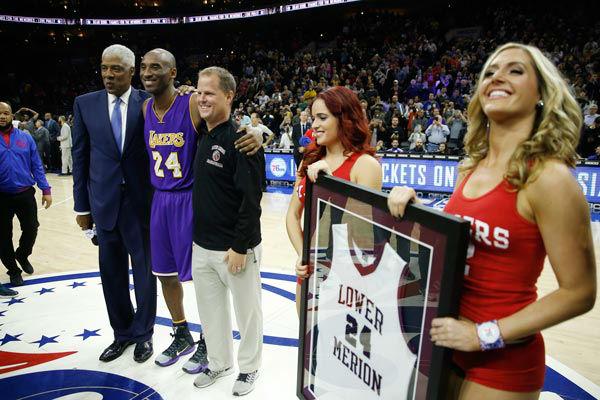 <div class='meta'><div class='origin-logo' data-origin='none'></div><span class='caption-text' data-credit='Photo/Matt Slocum'>Former NBA player Julius Erving, left, poses for photographs with Los Angeles Lakers' Kobe Bryant, second left, ahead of a basketball game.</span></div>