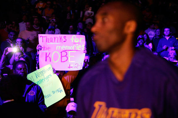 <div class='meta'><div class='origin-logo' data-origin='none'></div><span class='caption-text' data-credit='Photo/Matt Rourke'>A fan hold up a sign for Los Angeles Lakers' Kobe Bryant, right, ahead of a basketball game against the Philadelphia 76ers Tuesday, Dec. 1, 2015, in Philadelphia.</span></div>