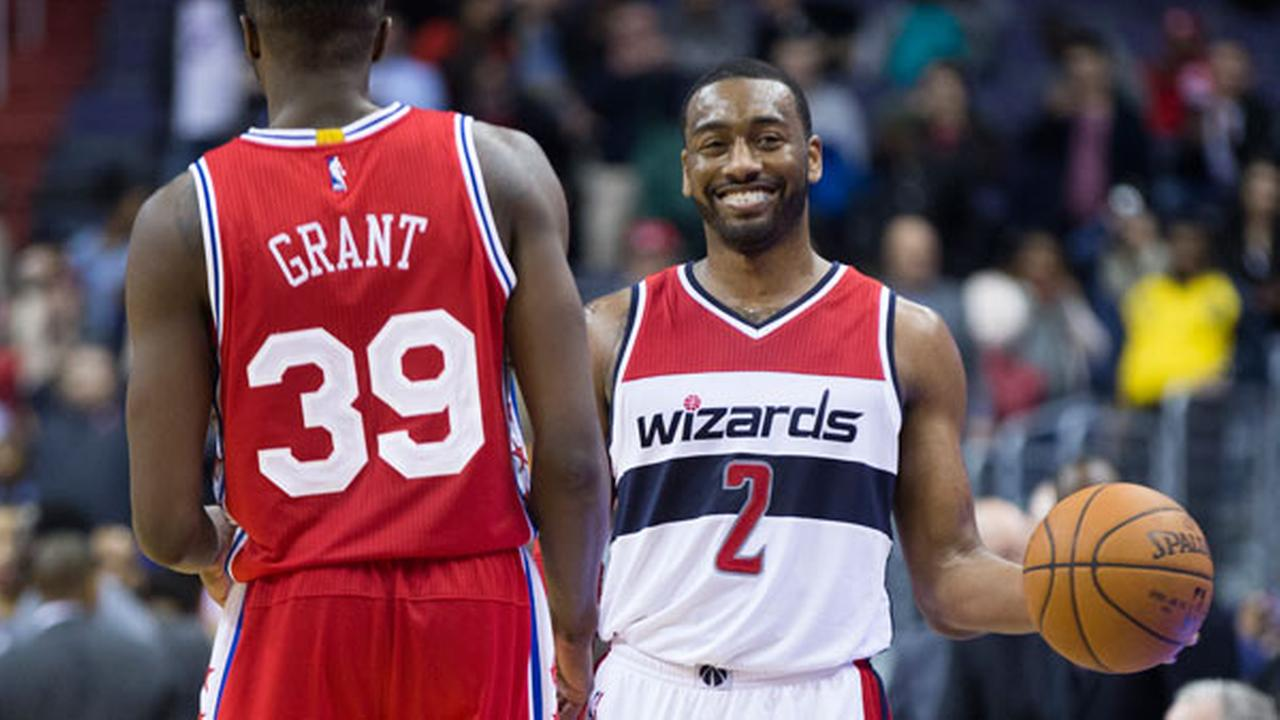 Philadelphia 76ers forward Jerami Grant (39) walks to congratulate Washington Wizards guard John Wall (2) at the end of an NBA basketball game.