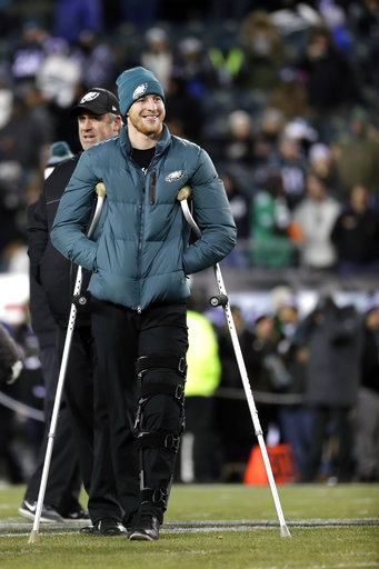 <div class='meta'><div class='origin-logo' data-origin='AP'></div><span class='caption-text' data-credit='AP Photo/Michael Perez'>Philadelphia Eagles' Carson Wentz walks with head coach Doug Pederson before an NFL football game against the Oakland Raiders, Monday, Dec. 25, 2017, in Philadelphia.</span></div>