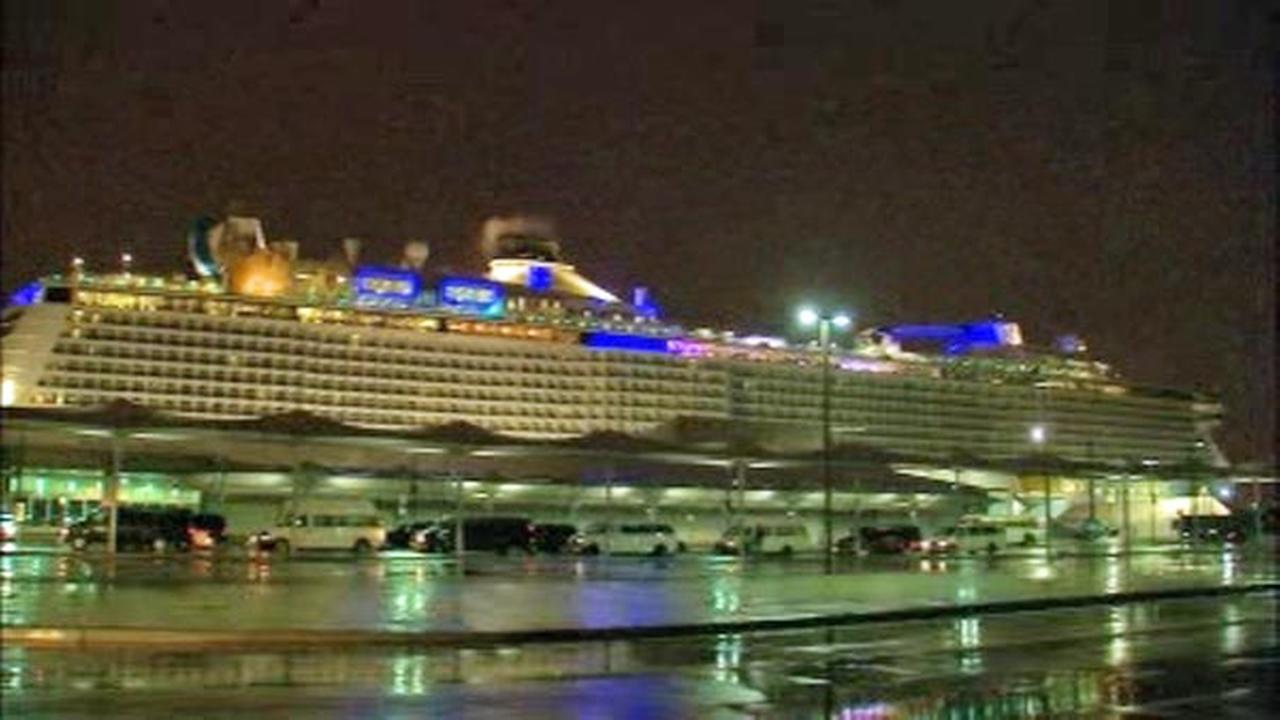 A cruise ship that was battered by a major Atlantic storm earlier this month has arrived back to port as another squall and a norovirus outbreak cut short its current voyage.