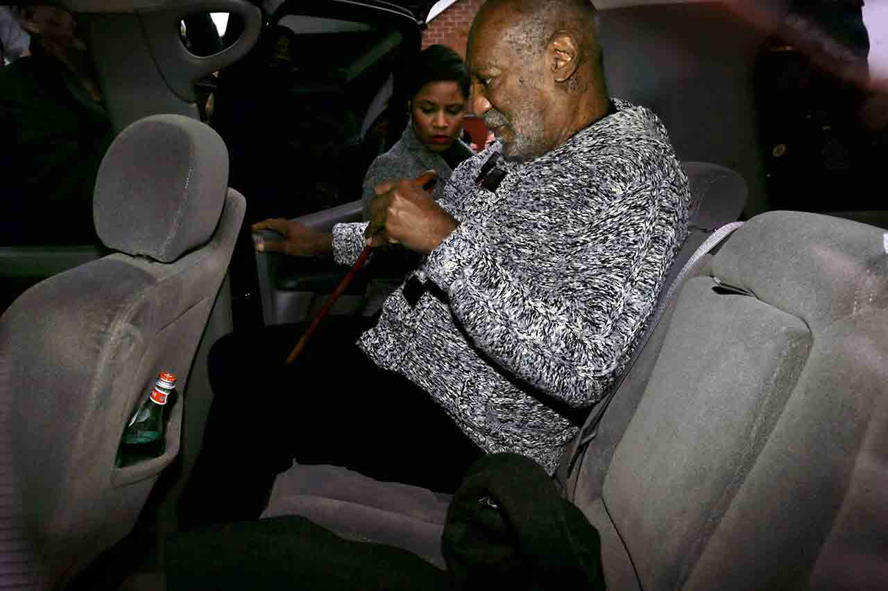 <div class='meta'><div class='origin-logo' data-origin='none'></div><span class='caption-text' data-credit='AP Photo/Mel Evans'>Actor and comedian Bill Cosby is helped into an SUV as he leaves a court appearance where he faced a felony charge of aggravated indecent assault Wednesday, Dec. 30, 2015.</span></div>