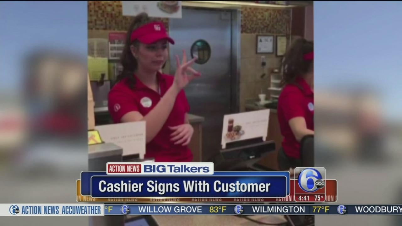 VIDEO: Cashier signs with customer