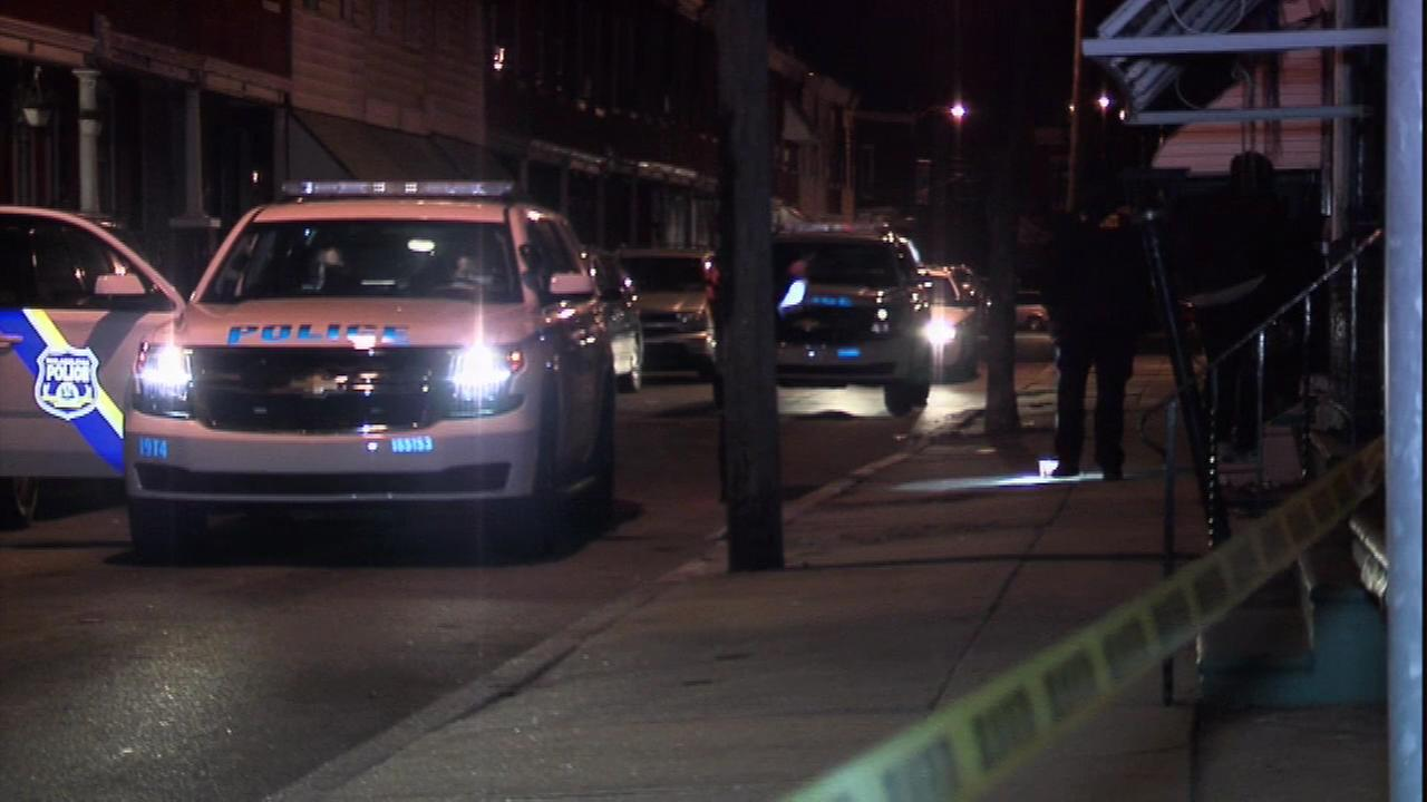 Police say an 18-year-old woman is dead after being hit by a stray bullet in West Philadelphia.