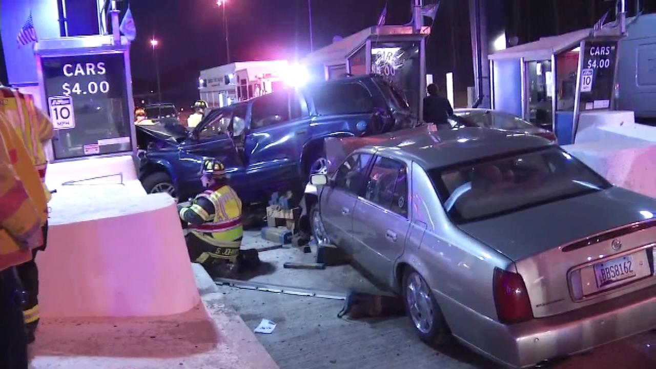 Four people are hospitalized after an accident at a Delaware toll plaza.