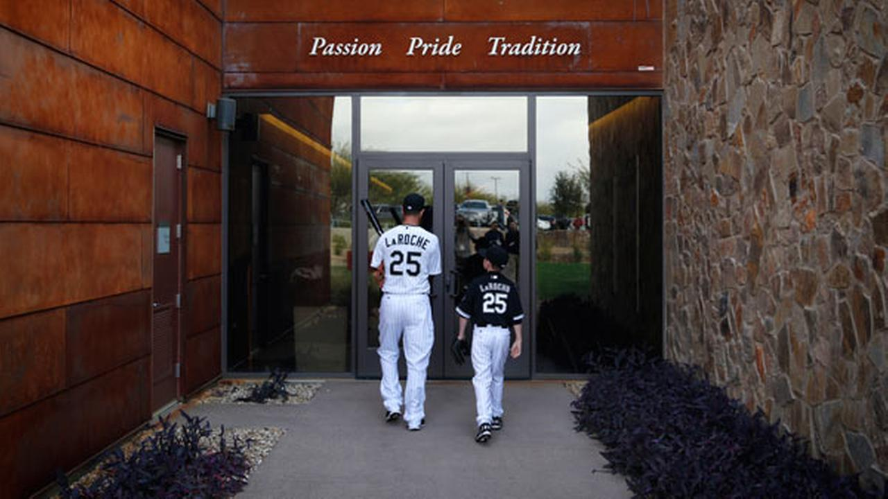 Chicago White Soxs Adam LaRoche, left, and his son Drake walk into the White Sox clubhouse during a photo day before a baseball spring training workout, Saturday, Feb. 28, 2015.
