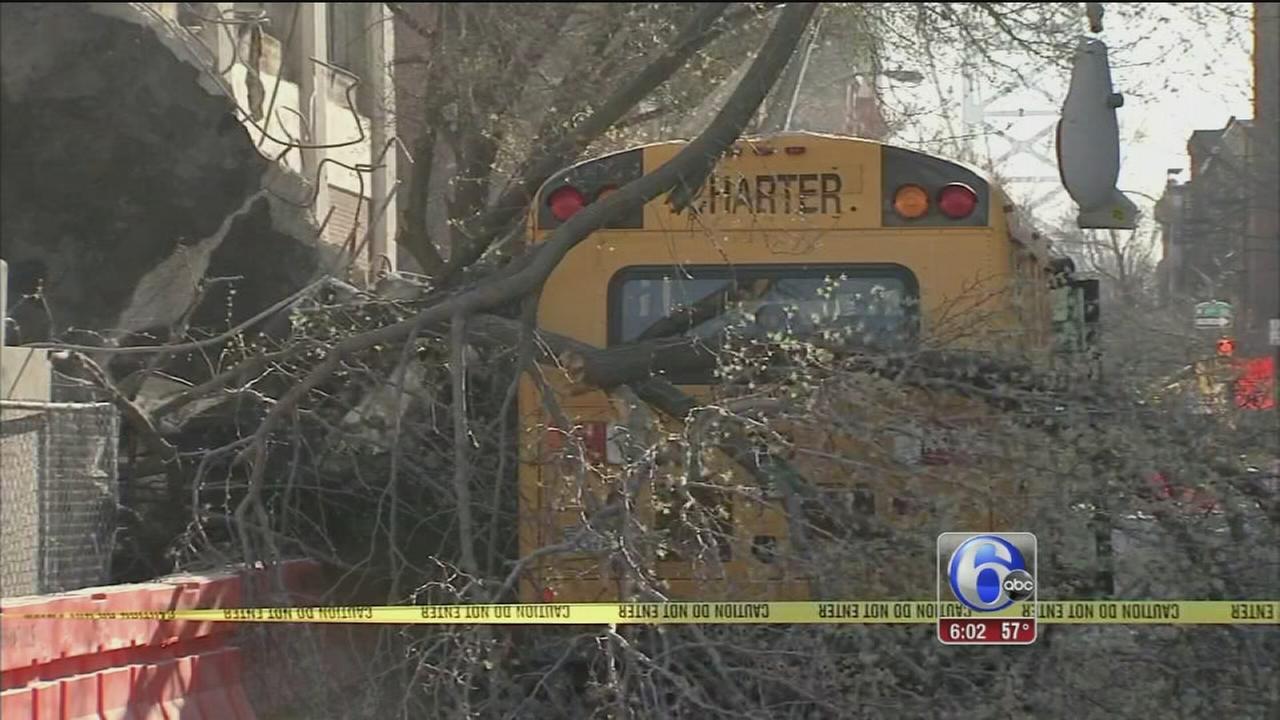 VIDEO: Partial building collapse damages school bus