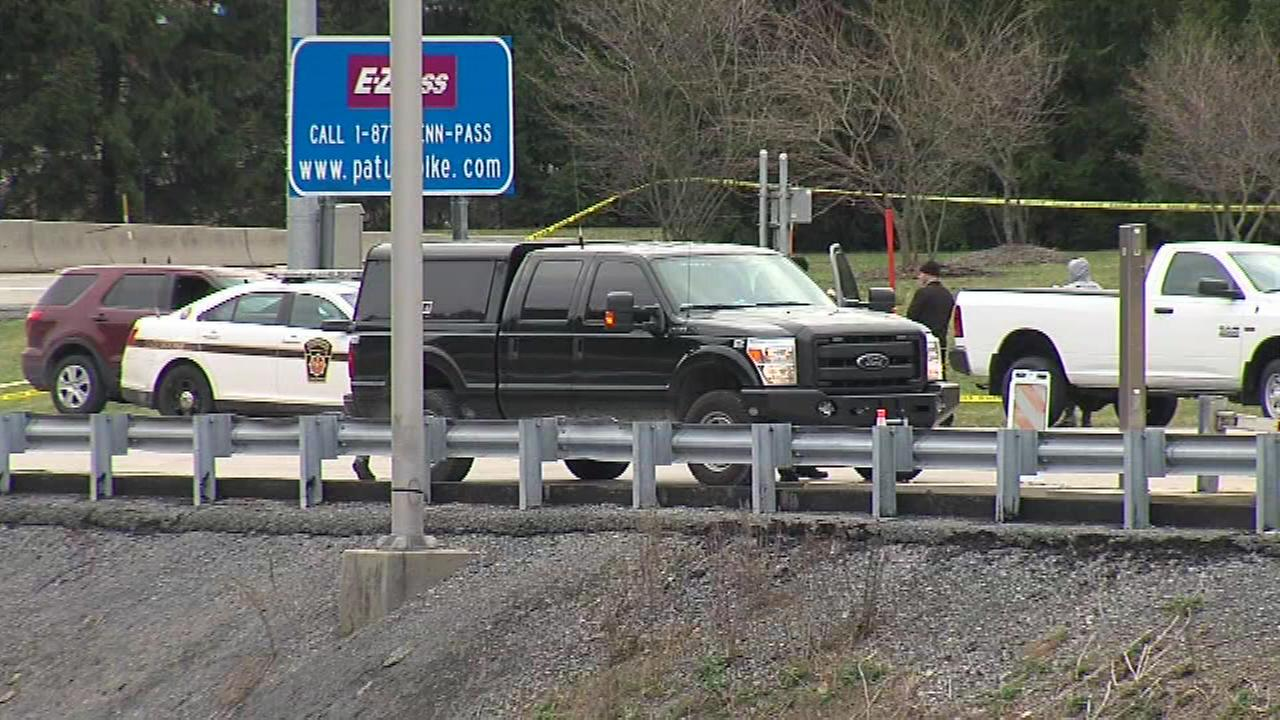 Pictured: The scene of a shooting that left two victims and the gunman, a former Pa. State Police Trooper, dead on the Pa. Turnpike in Fort Littleton, Pa. on Sunday, March 20th.