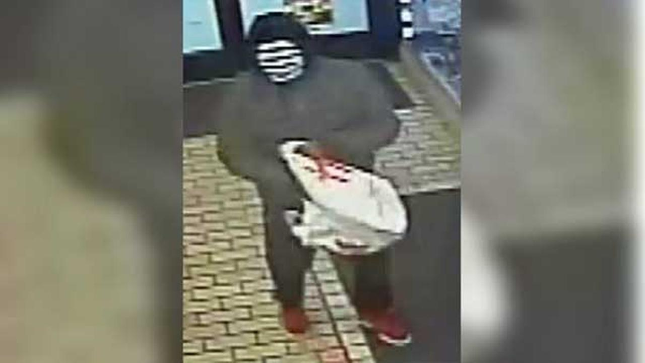 Pictured: One of two masked suspects who robbed Lucky Star Deli at gunpoint on the 7300 block of Elmwood Avenue in Southwest Philadelphia on March 16 shortly after 3 a.m.