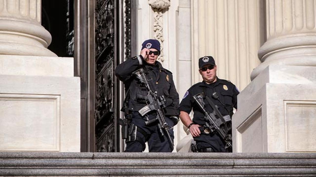 U.S. Capitol Police officers stand guard outside at the entrance to the House of Representatives on Capitol Hill in Washington, Tuesday, March 22, 2016.