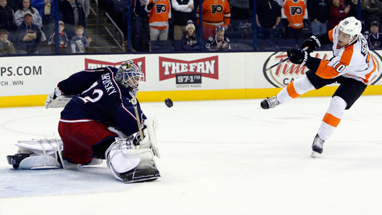 Columbus Blue Jackets Sergei Bobrovsky, left, of Russia, makes a save against Philadelphia Flyers Brayden Schenn during the shootout of an NHL hockey game Tuesday, March 22, 2016