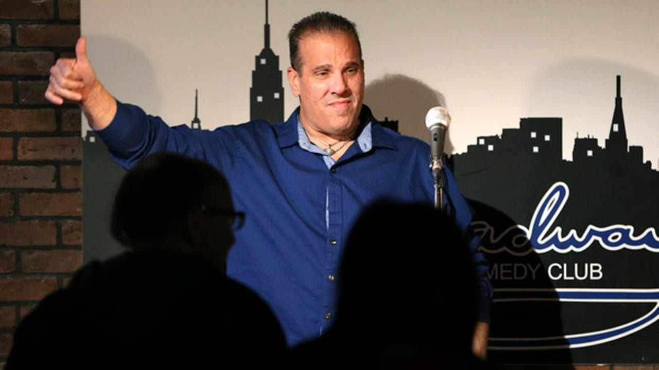In this March 20, 2016 photo, actor-comedian Carlo Goias, of Toms River, N.J., gives a thumbs-up to an audience at the Broadway Comedy Club in New York.