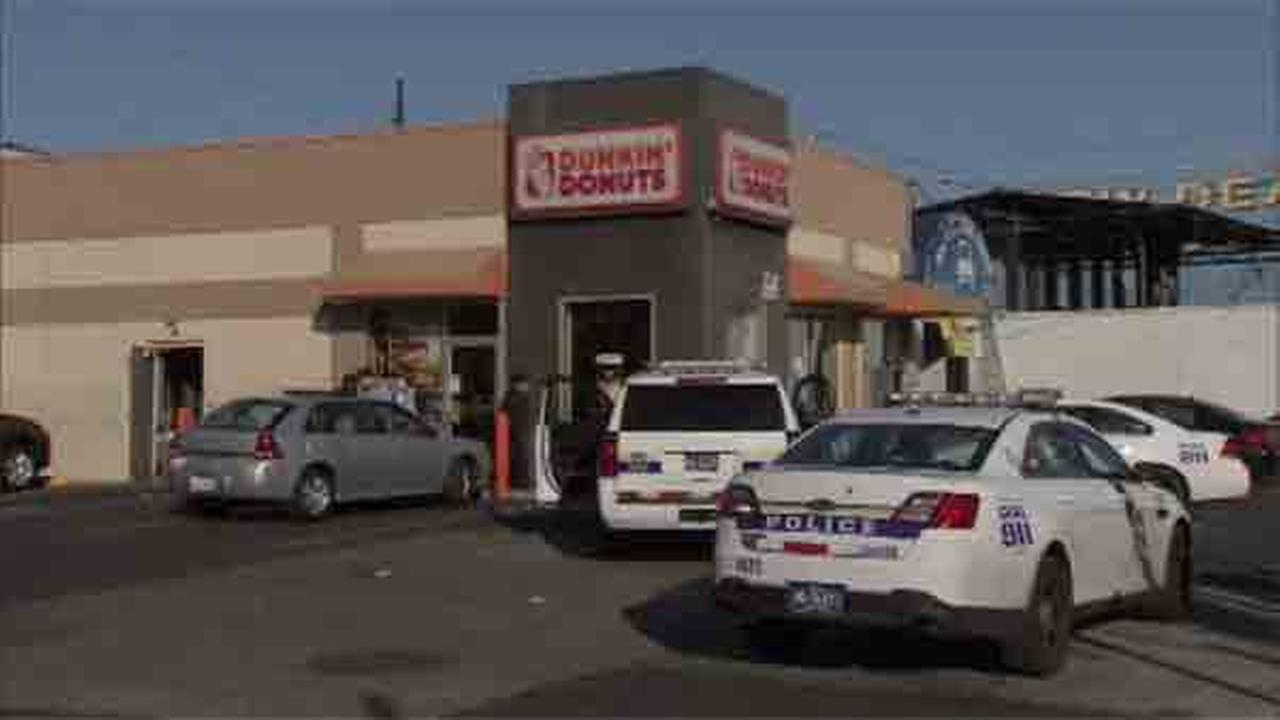 Police are looking for two suspects in connection with an armed robbery at a doughnut shop in West Philadelphia.