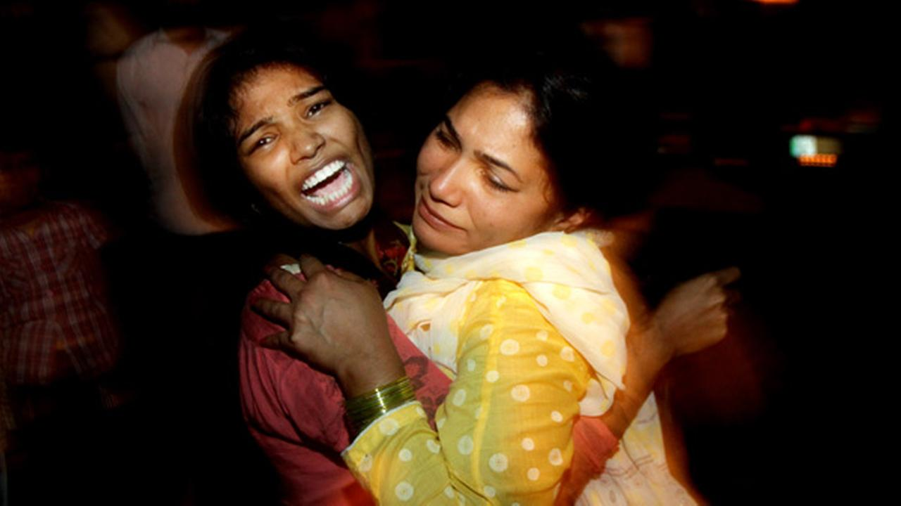 Women comfort each other as they mourn over the death of a family member who was killed in a bomb blast, at a local hospital in Lahore, Pakistan, Sunday, March, 27, 2016.AP Photo/K.M. Chuadary