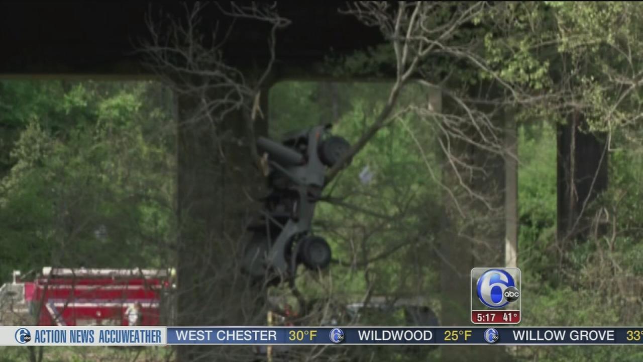 VIDEO: Jeep flips from bridge, lands in tree