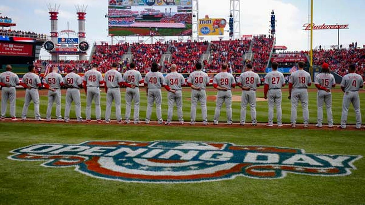 The Philadelphia Phillies line up before an opening day baseball game against the Cincinnati Reds, Monday, April 4, 2016, in Cincinnati.