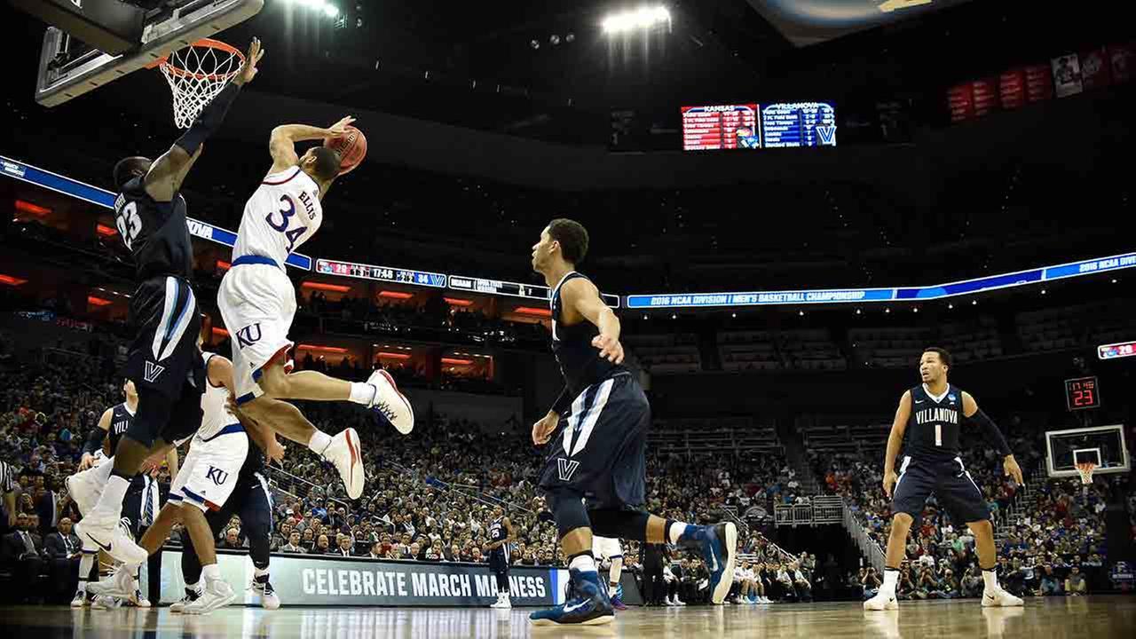 Kansas forward Perry Ellis (34) shoots against Villanova forward Daniel Ochefu (23) during the second half of a regional final mens college basketball game in the NCAA Tournament.