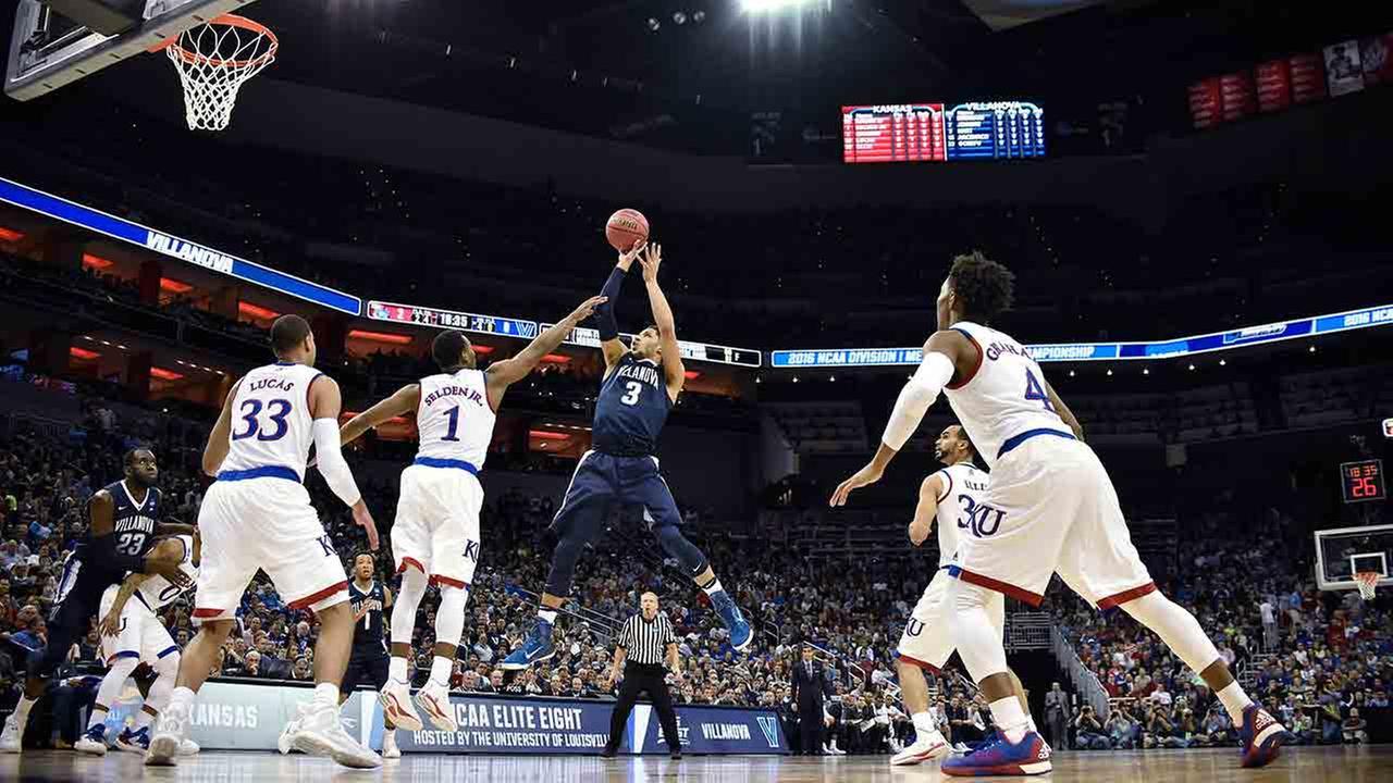 Villanova guard Josh Hart (3) shoots against Kansas guard Wayne Selden Jr. (1) during the second half of a regional final mens college basketball game in the NCAA Tournament.