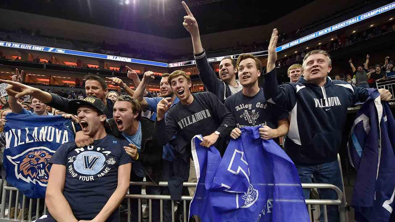 Villanova guard Ryan Arcidiacono, left, is embraced by fans after a regional final mens college basketball game in the NCAA Tournament against Kansas.