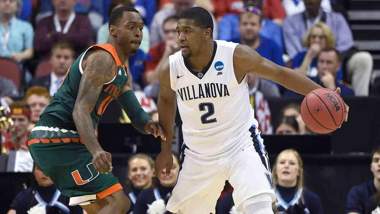 Nova forward Kris Jenkins is guarded by Miami guard Sheldon McClellan in the second half of an NCAA college basketball game in the regional semifinals of the mens NCAA Tournament.