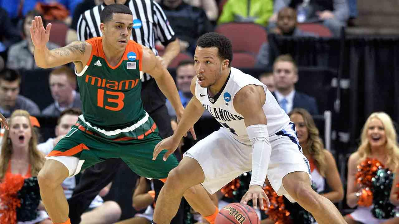 Nova guard Jalen Brunson is guarded by Miami guard Angel Rodriguez during the first half of an NCAA college basketball game in the regional semifinals of the mens NCAA Tournament.