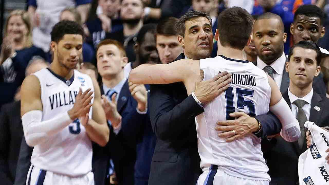 Villanovas Ryan Arcidiacono (15) hugs head coach Jay Wright during the second half of a second-round mens college basketball game in the NCAA Tournament.