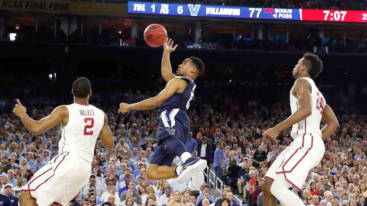 Villanova guard Phil Booth (5) shoots against Oklahoma guard Dinjiyl Walker (2) during the second half of the NCAA Final Four tournament college basketball semifinal game.