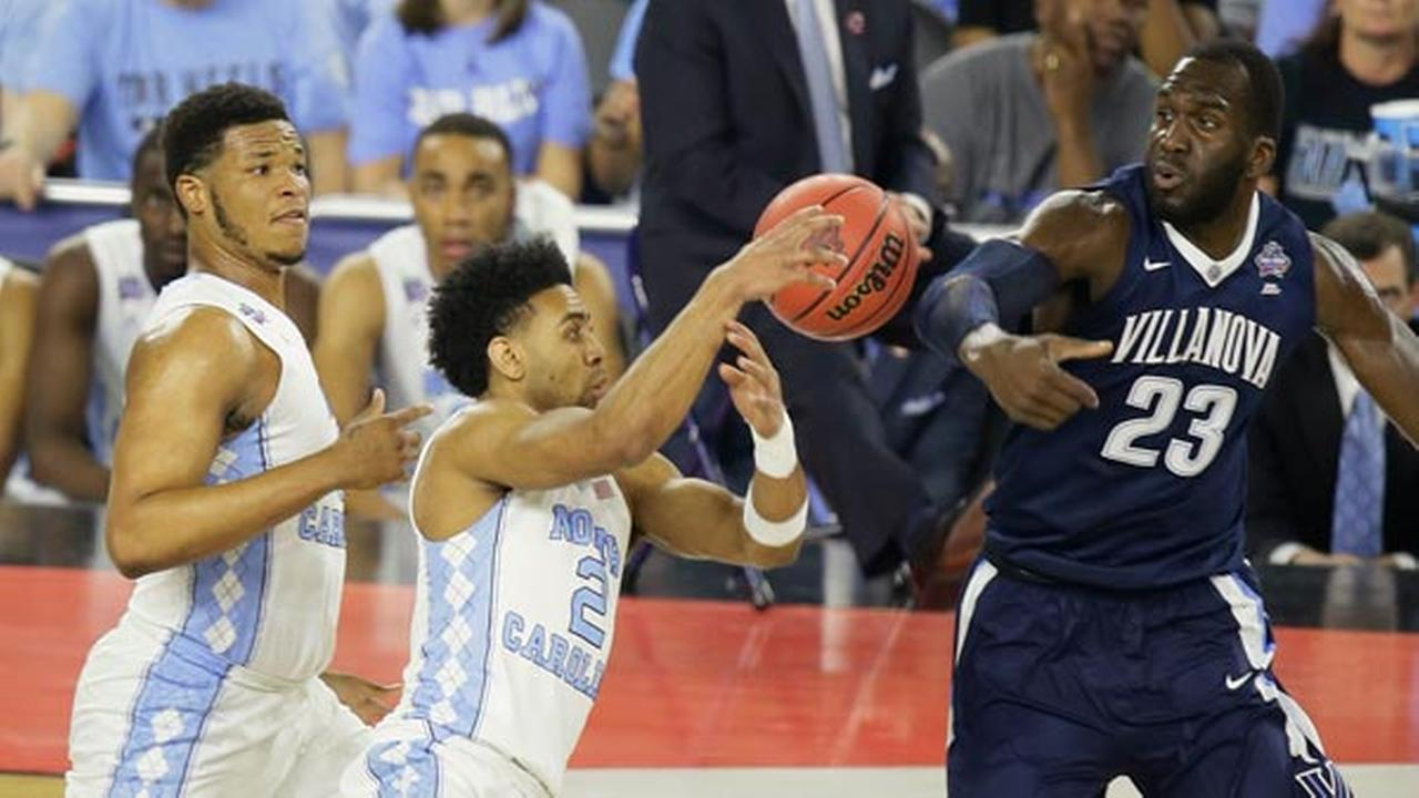 North Carolinas Kennedy Meeks (3), Joel Berry II (2) and Villanovas Daniel Ochefu (23) battle for a loose ball during the first half of the NCAA Final Four championship game.AP Photo/Charlie Neibergall