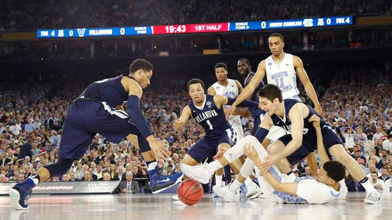 North Carolina forward Justin Jackson (44), Villanova guard Jalen Brunson (1), Villanova guard Ryan Arcidiacono (15), vie for a loose ball during the first half.AP Photo/Eric Gay