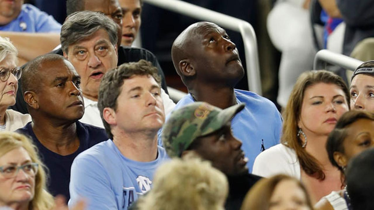 Former North Carolina and NBA basketball player and principal owner and chairman of the Charlotte Hornets Michael Jordan watches the scoreboard.AP Photo/David J. Phillip