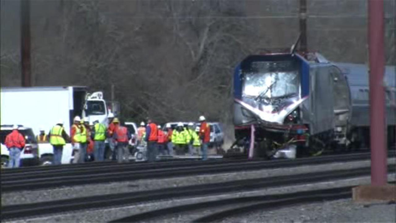Officials: Amtrak engineer hit brakes seconds before crash
