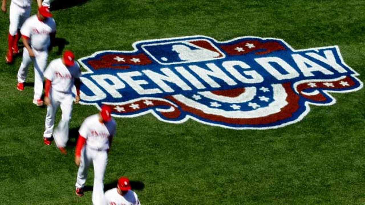 Philadelphia Phillies walk to the dugout ahead of their home opening day baseball game against the San Diego Padres, Monday, April 11, 2016, in Philadelphia.