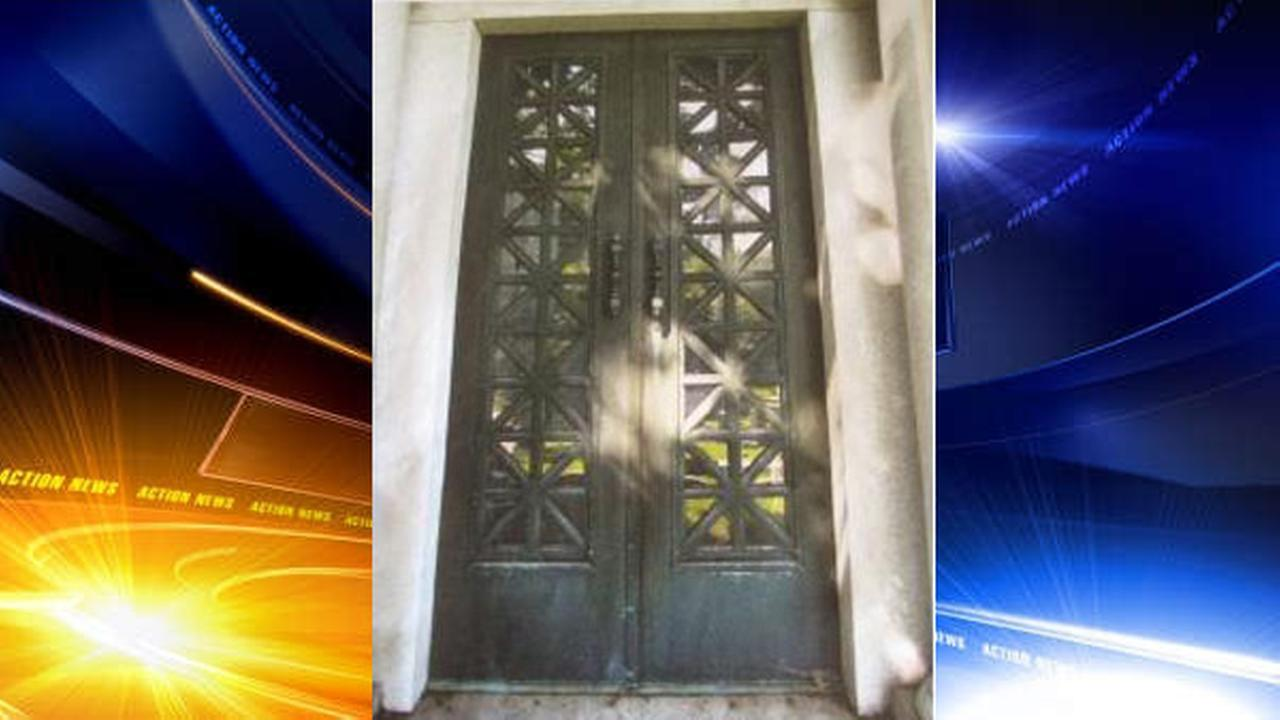 Plywood now covers the entrance where those ornate doors stood for more than 100 years. & 25000 mausoleum doors stolen from Philadelphia cemetery | 6abc.com