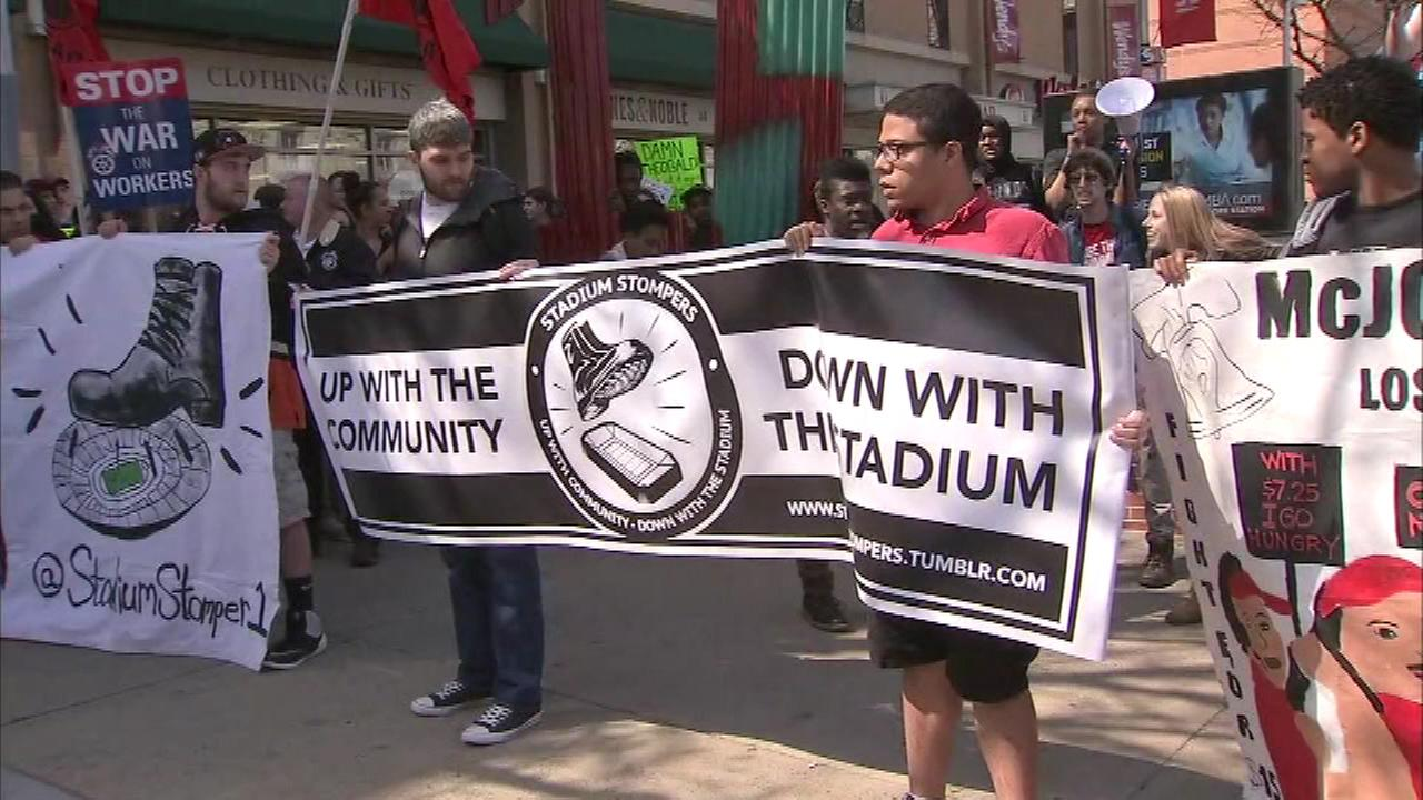 Protesters voicing their opinions on various concerns, including the minimum wage and Temple Universitys proposed new stadium, marched down Broad Street Thursday afternoon.