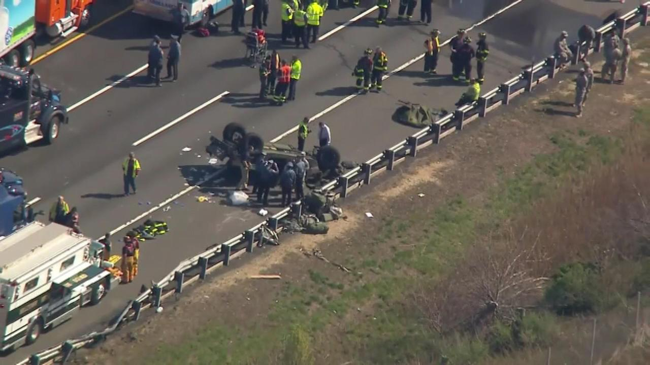 Four soldiers were injured Thursday when their Humvee overturned on the New Jersey Turnpike in South Brunswick.