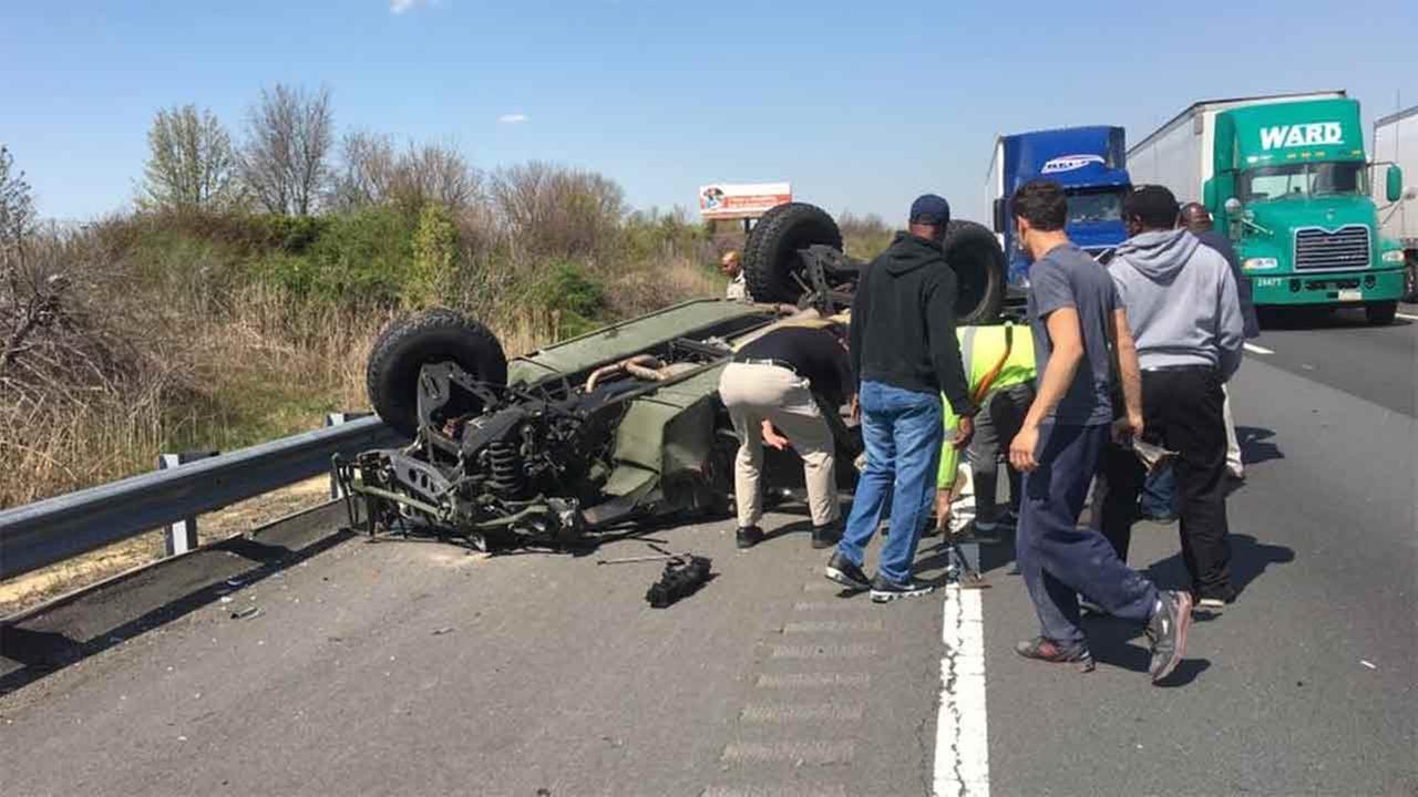 Four soldiers were injured Thursday when their Humvee overturned on the New Jersey Turnpike in South Brunswick. (Photo credit: Michael Watsey)
