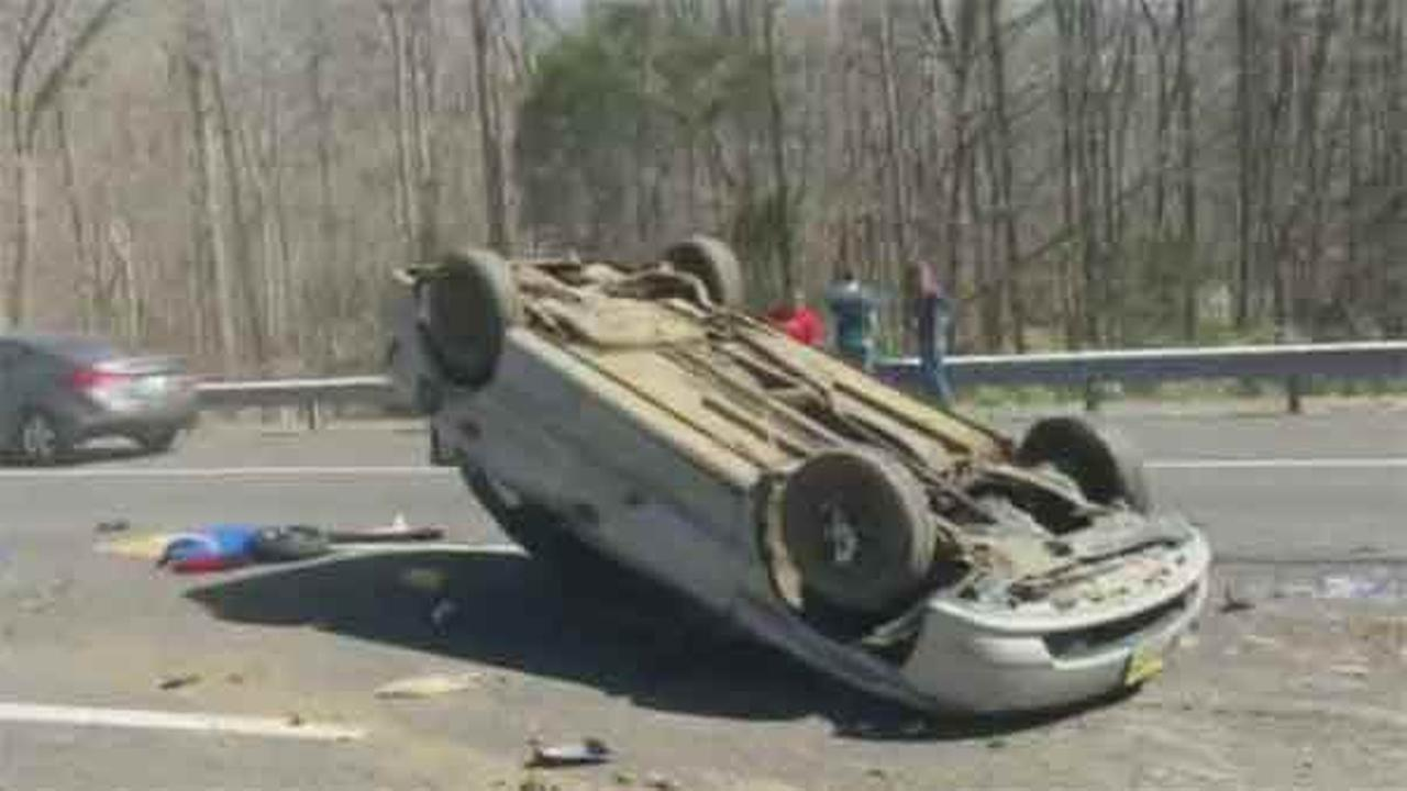 Driver Suffers Minor Injuries After Car Flips Over On I