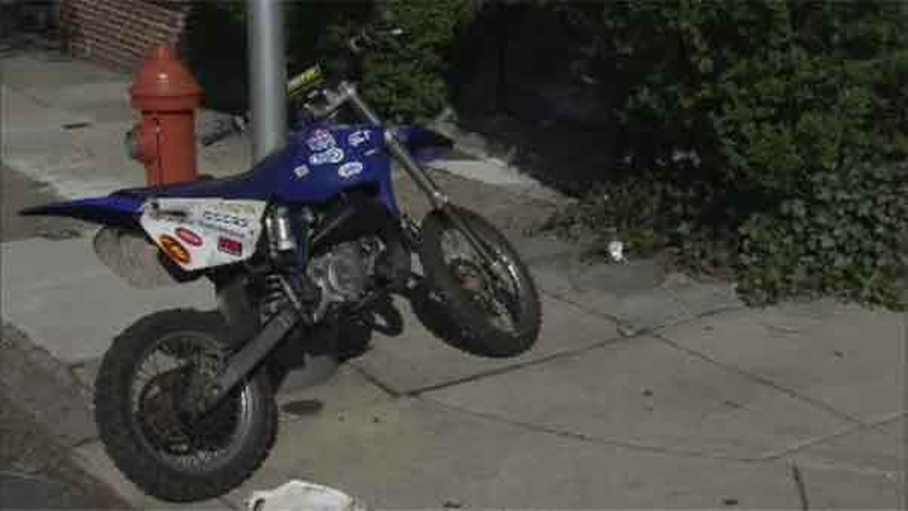 Police say a child was injured when a dirt bike crashed into a car in Southwest Philadelphia.