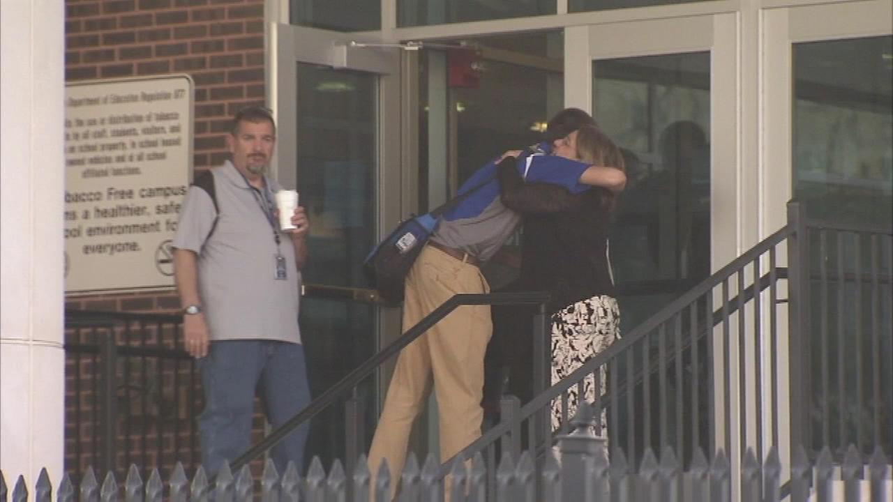 Students arrive at Howard High School of Technology in Wilmington one day after a classmate died following a fight inside the school.