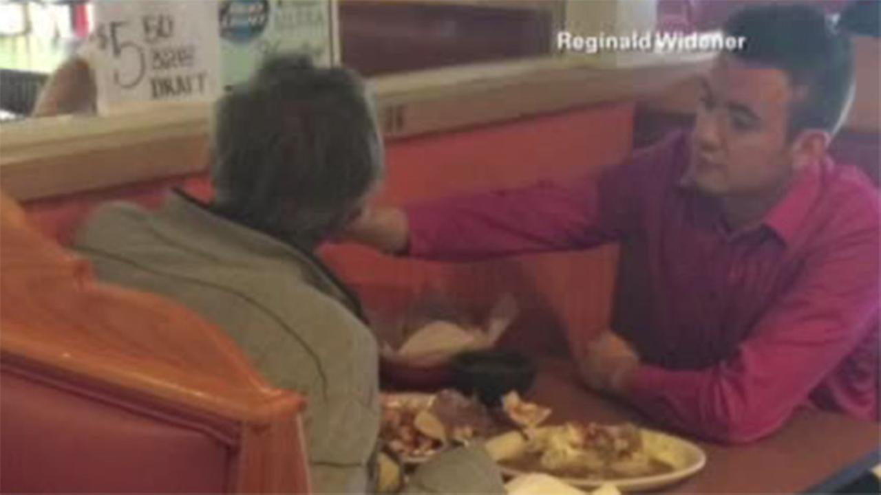 Waiter feeds man without hands in Georgia