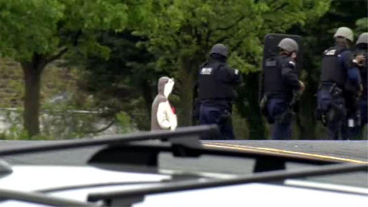 Bomb hooked to man in animal suit really flotation device
