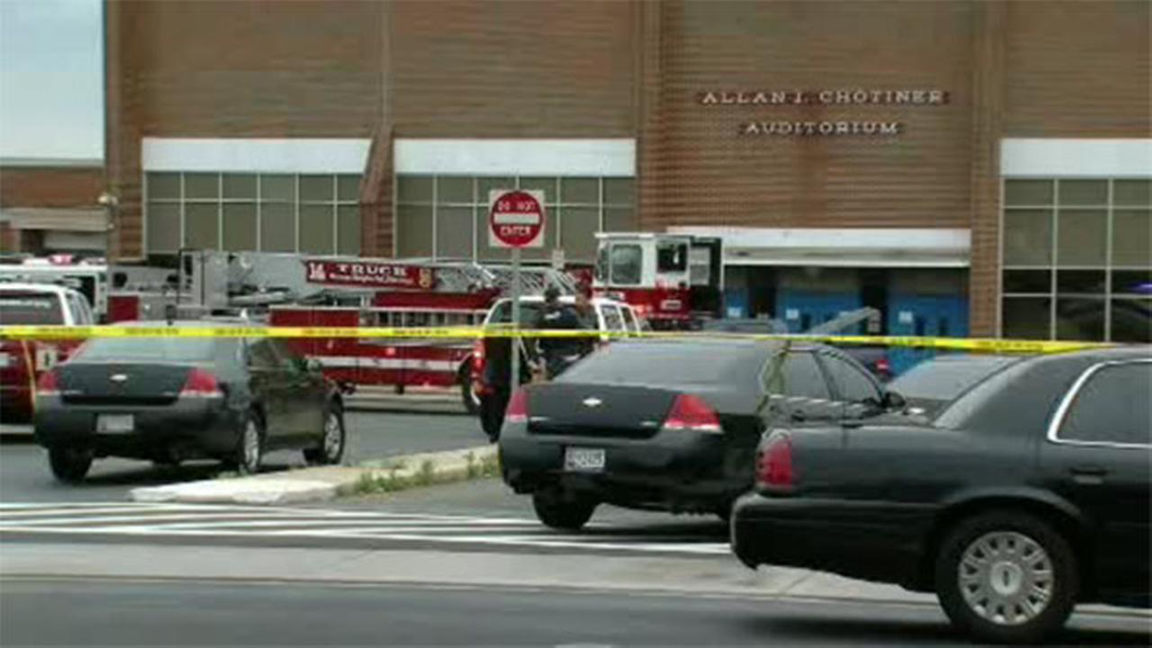 Police search for gunman sought in fatal shooting at school
