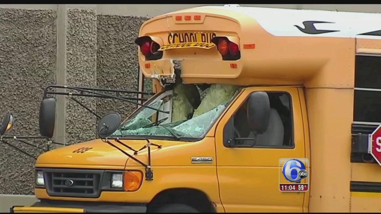 VIDEO: Tire crashes into school bus