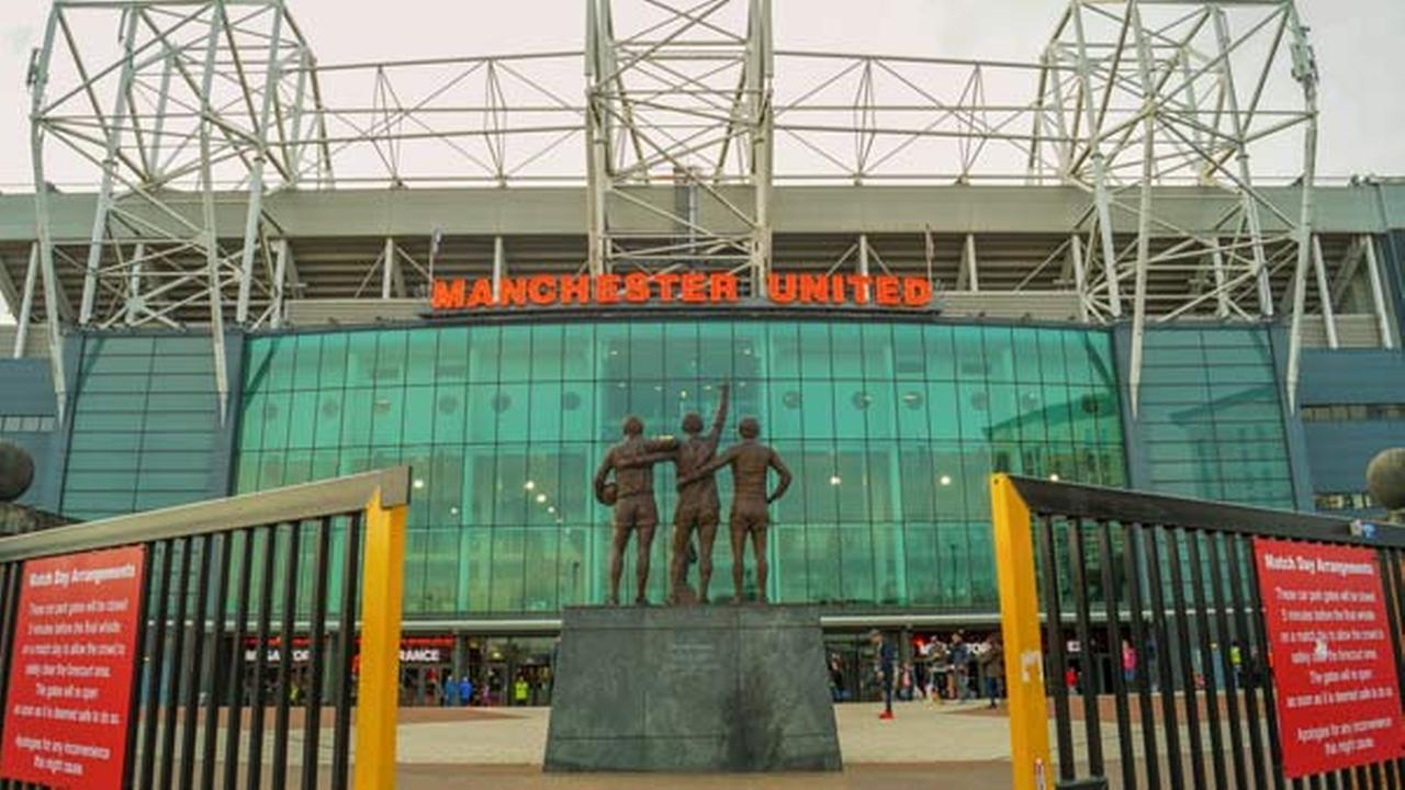 FILE: The entrance of the Old Trafford stadium. Old Trafford is the home stadium of Manchester United Football Club since 1910.