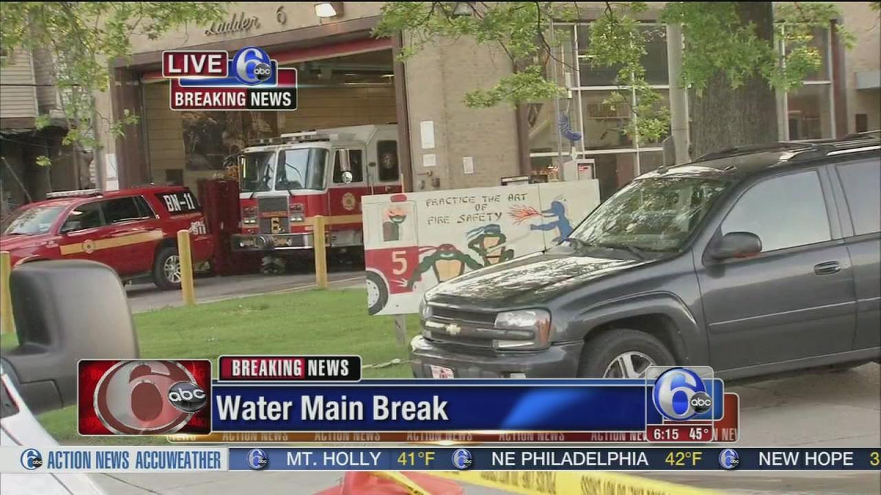 VIDEO: Water main break floods fire house