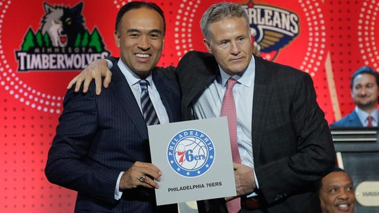 NBA deputy commissioner Mark Tatum, left, poses for a photo with Philadelphia 76ers head coach Brett Brown during the NBA basketball draft lottery, Tuesday, May 17, 2016.