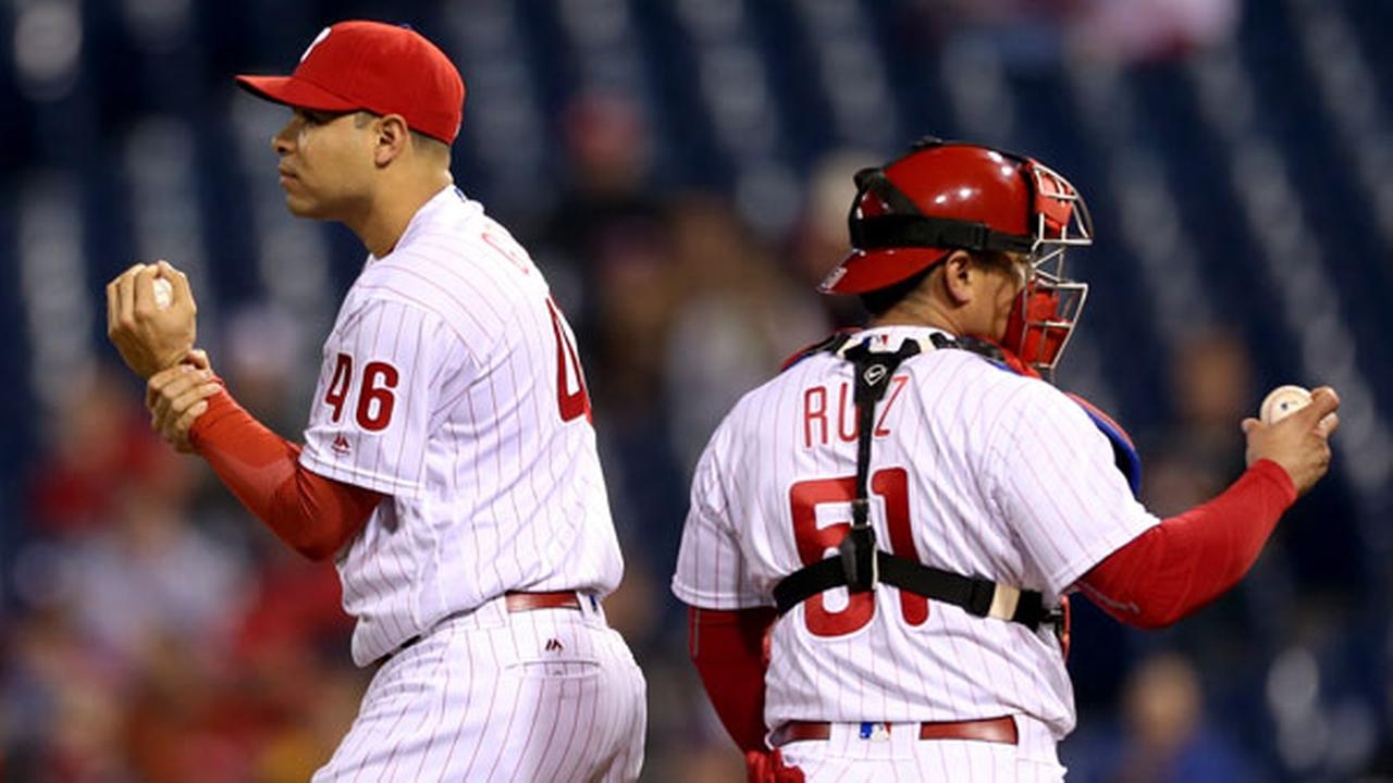 Philadelphia Phillies relief pitcher Jeanmar Gomez (46) returns to the mound after conferring with catcher Carlos Ruiz in the ninth inning of a baseball game, Tuesday, May 17, 2016
